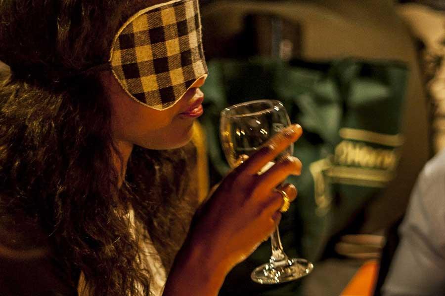 Blindfolded dinner - women drinking