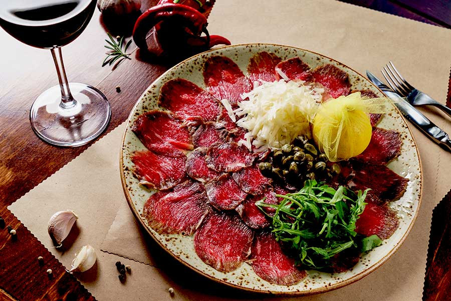 Carpaccio with capers rucola