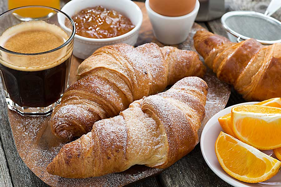 French food - delicious breakfast croissant and coffee