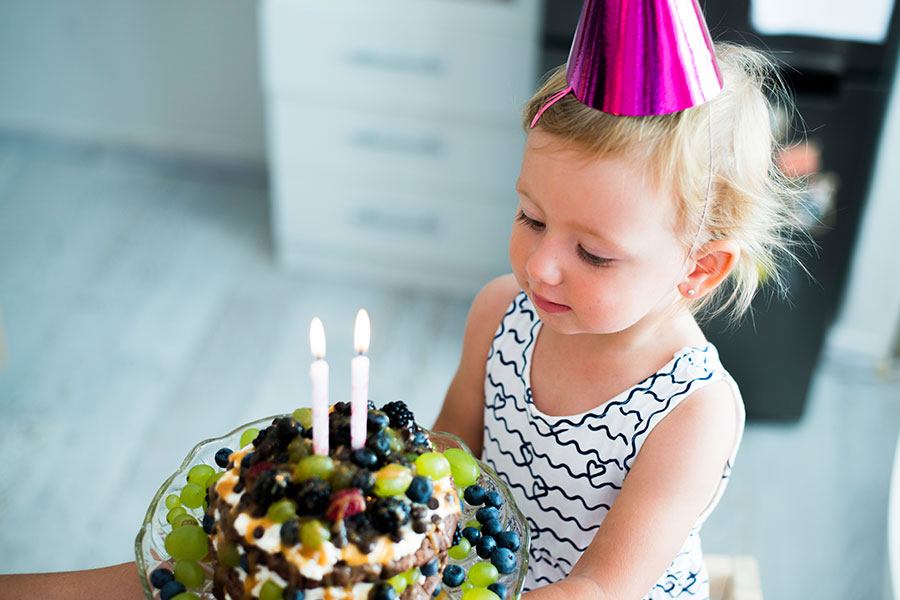 Kids birthday - blowing a candles on the cake