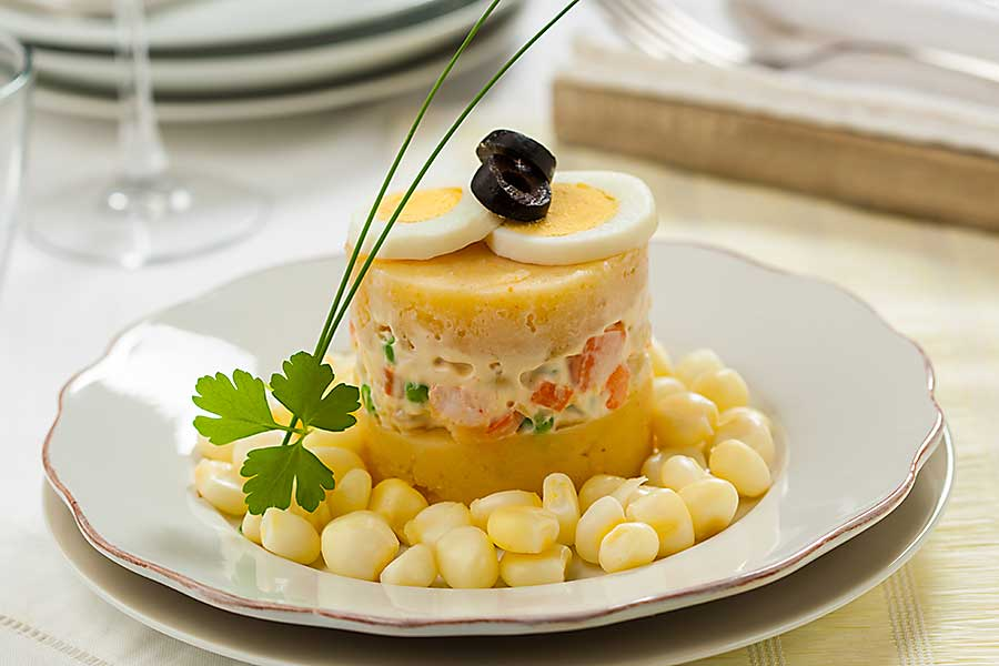 Causa rellena, layered potato and chicken, a typical dish from Peru