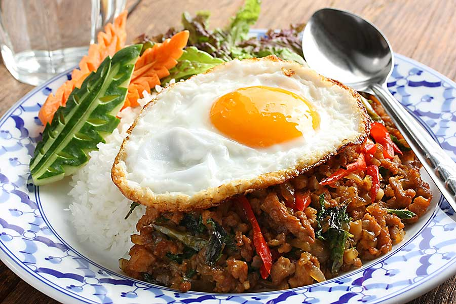 Thai cuisine - stir fried chicken with holy basil , gai pad bai gaprow.
