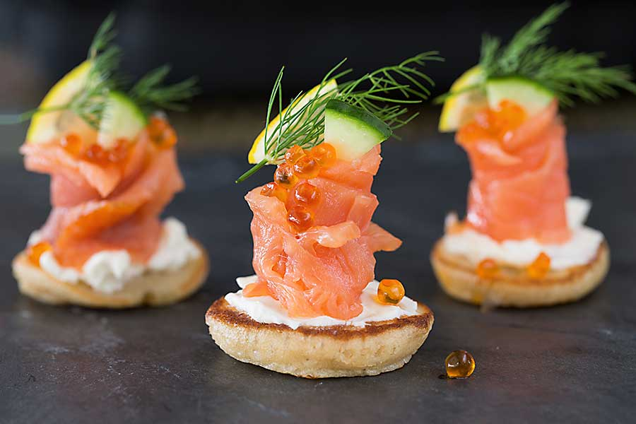 Blini canapes with salmon