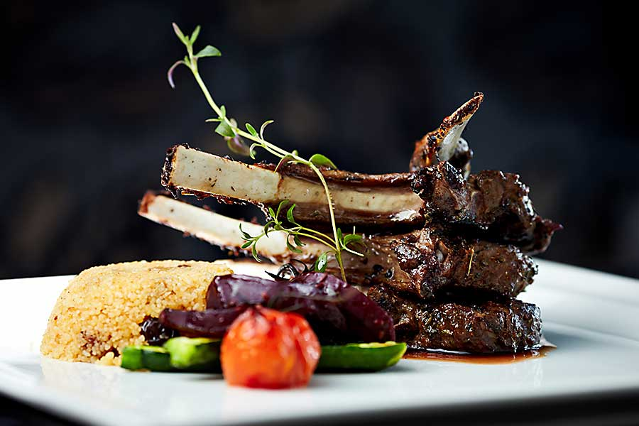 Morrocan food - grilled lamb carre with warm couscous salad, roasted vegetables
