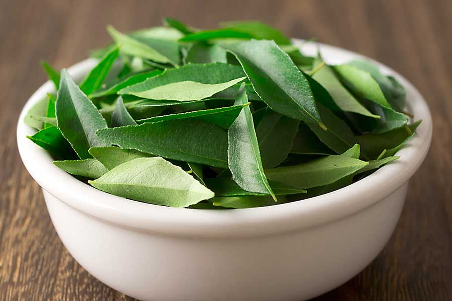 Curry leaves in the bowl