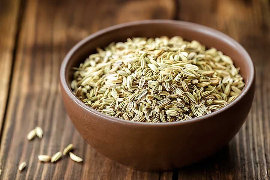 Fennel seeds in the wooden bowl