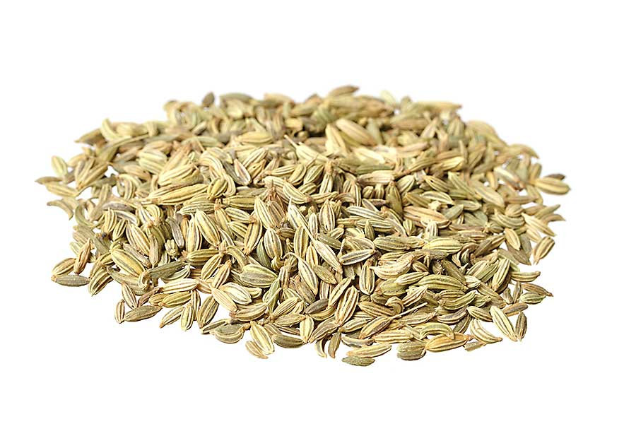 Fennel seeds closeup on white