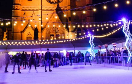 SYDNEY, AUSTRALIA - JULY 1, 2017: People ice skating outdoor in front of St Marys cathedral for Sydney Winter Festival