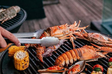 Lobster and mix seafood barbecue cooking on grill